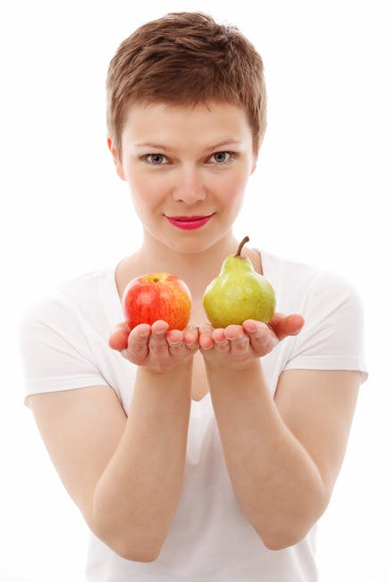 Woman With Fruits On Her Hands