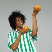 Photo Of Smiling Woman In White And Green Stripe Shirt